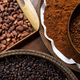 Different types of coffee beans on the plates - PhotoDune Item for Sale