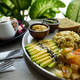 Vegan tofu with avocado, bread, vegetables and source close-up on a plate. - PhotoDune Item for Sale