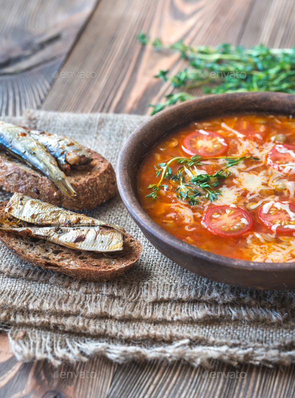 Portion of green lentil tomato soup with toasts - Stock Photo - Images
