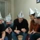 Friends in Foil on the Head of the House. Gathering of Friends About Listening To Their Ideas of - VideoHive Item for Sale
