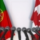 Flags of Portugal and Canada at International Press Conference