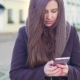 Young Woman Uses a Mobile Phone in the City - VideoHive Item for Sale