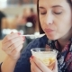 Woman Eating Ice Cream in a Cafe - VideoHive Item for Sale