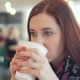 Woman Is Drinking a Drink in a Cafe - VideoHive Item for Sale