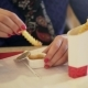 a Woman Eats Fast Food in a Cafe - VideoHive Item for Sale