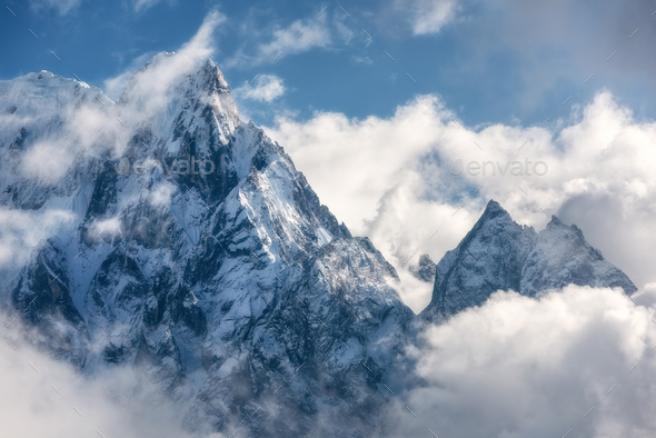 Mountains with snowy peaks in clouds in Nepal - Stock Photo - Images