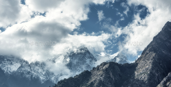Majestical scene with mountains in clouds - Stock Photo - Images