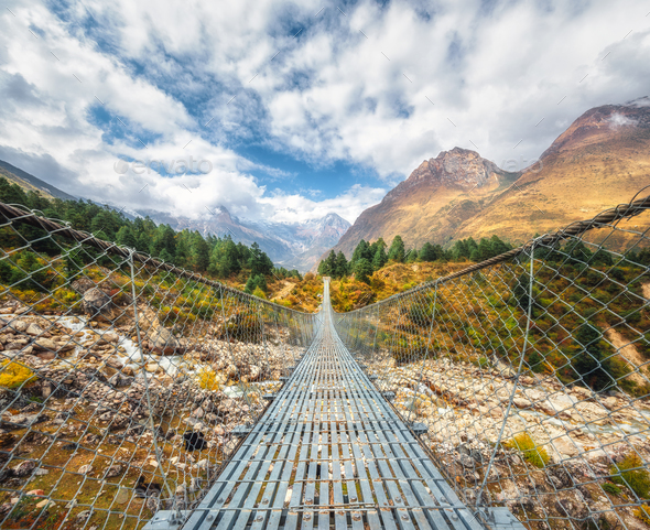 Suspension bridge and beautiful himalayan mountains - Stock Photo - Images