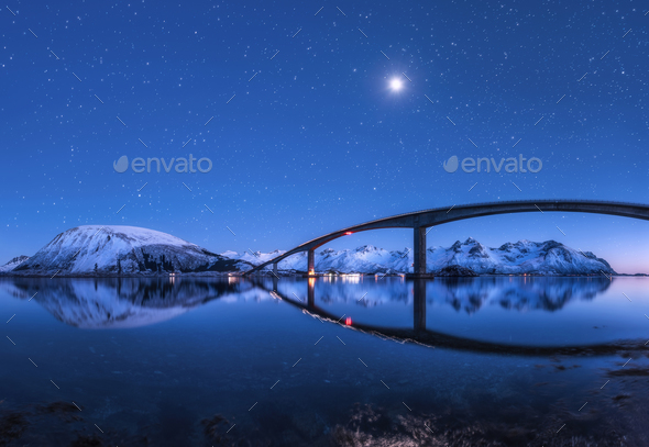 Bridge and starry sky with reflection in water - Stock Photo - Images