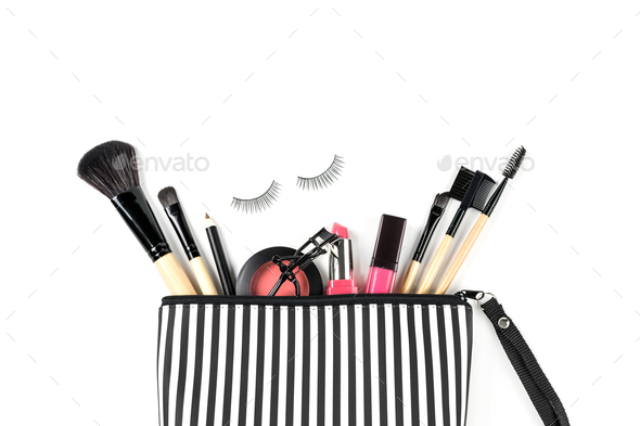 Make up bag with various cosmetics and brushes isolated - Stock Photo - Images