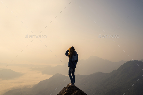 Young traveler standing and looking at beautiful landscape - Stock Photo - Images