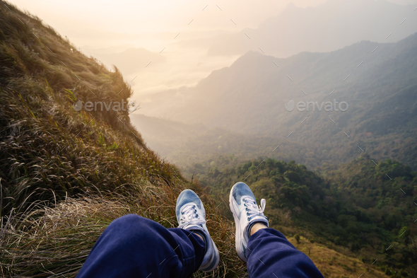 Traveler sitting and looking at view of nature - Stock Photo - Images