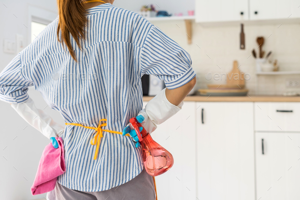 Tired young woman standing at kitchen room - Stock Photo - Images