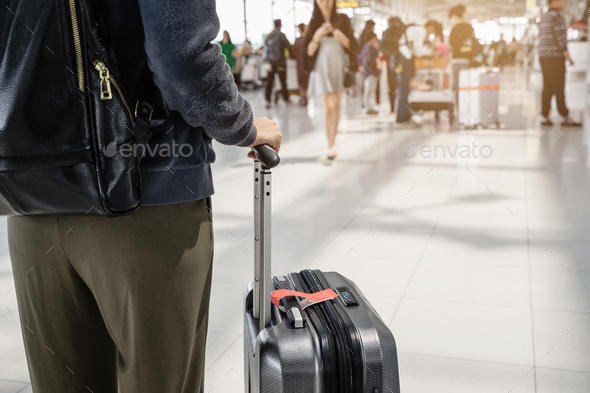 Young woman traveller walking in airport terminal hal - Stock Photo - Images