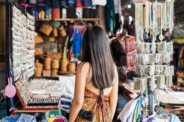 Young woman traveler at ubud market in bali - Stock Photo - Images