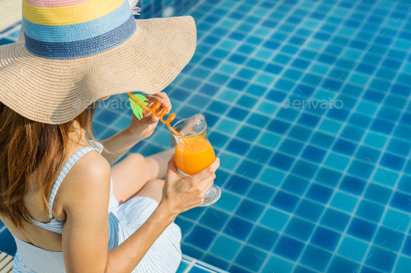 Woman relaxing at swimming pool, Summer vacation - Stock Photo - Images