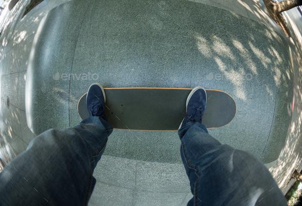Skateboarding legs on ramp - Stock Photo - Images