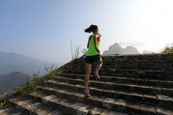 Running upstairs to mountain top - Stock Photo - Images