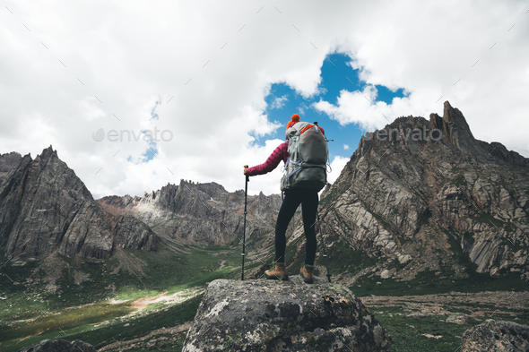Hiking in high altitude mountains - Stock Photo - Images