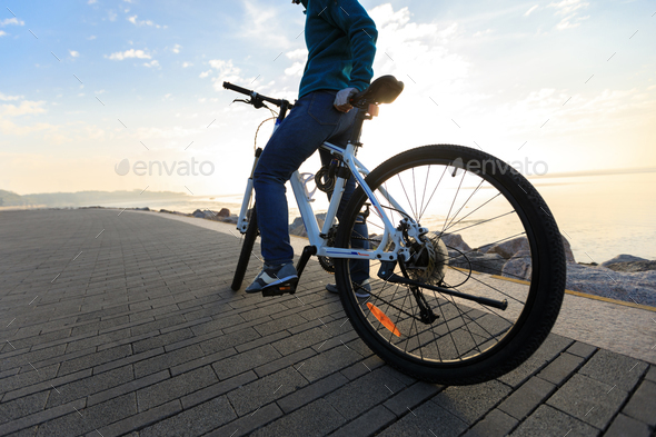 Cycling on morning coast - Stock Photo - Images
