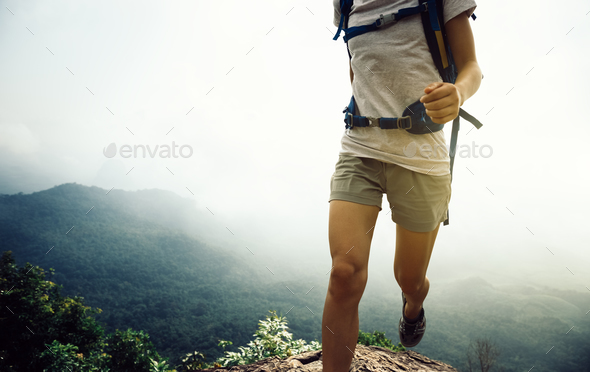 Running up to mountain top - Stock Photo - Images