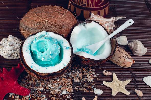 Blue ice cream in coconut bowl. Summer vacation - Stock Photo - Images