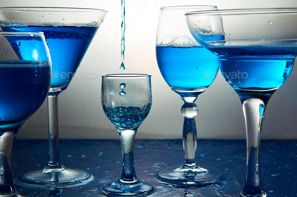 Many glasses with blue champagne or cocktail. - Stock Photo - Images