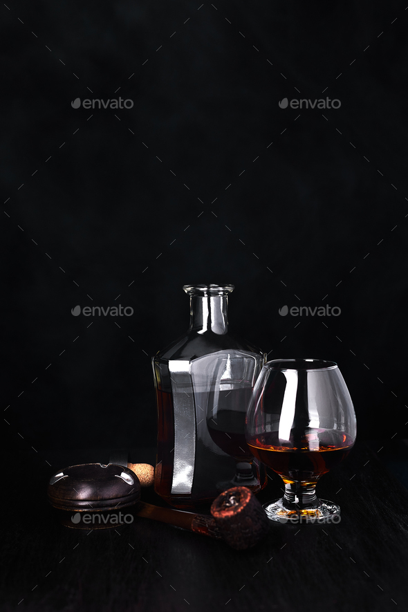 Glass of whiskey with smoking cigar. whisky, tobacco - Stock Photo - Images