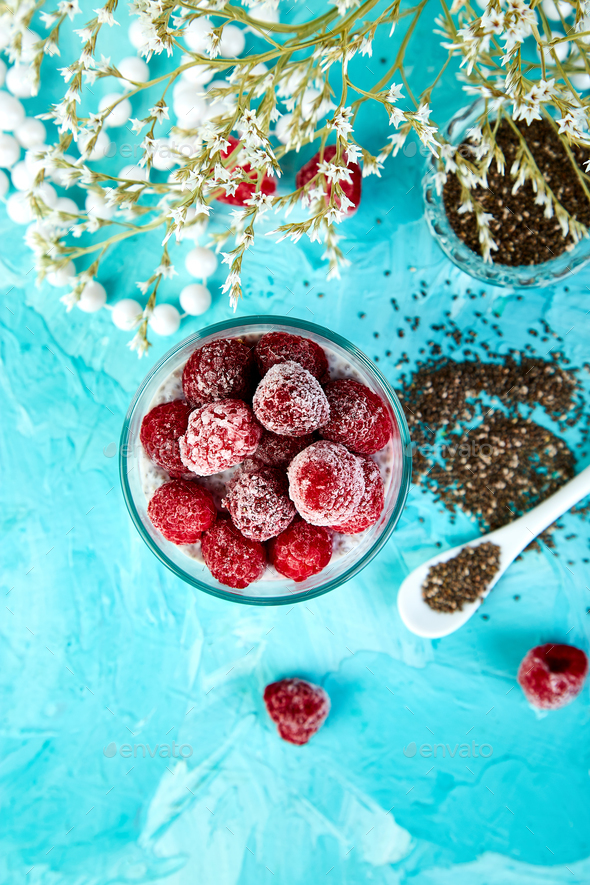 Healthy chia pudding with raspberries in glass - Stock Photo - Images