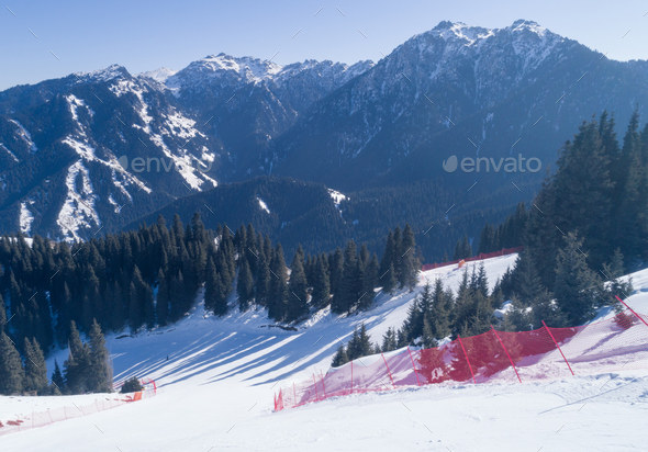 Ski slope in alpine mountians - Stock Photo - Images
