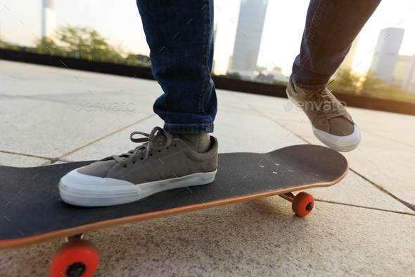 Skateboarding in city - Stock Photo - Images