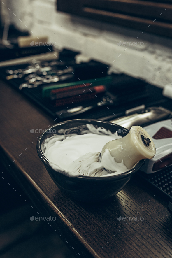 Barber shop tools on the table. Close up view shaving foam. - Stock Photo - Images