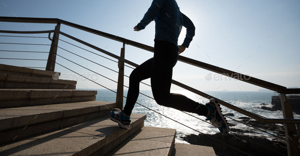 Running upstairs on sunrise coast - Stock Photo - Images