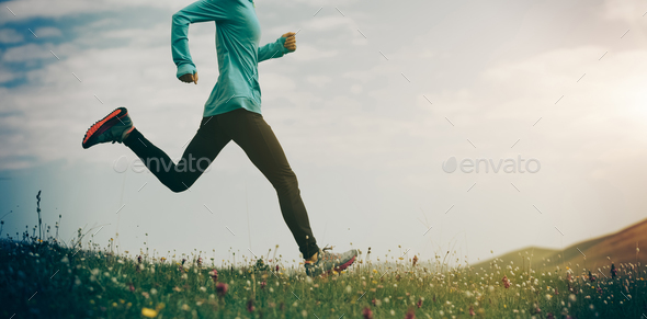 Running in grass and flowers - Stock Photo - Images