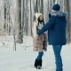 Couple Walking through the Winter Forest - VideoHive Item for Sale