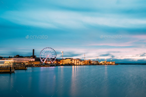 Helsinki, Finland. View Of Embankment With Ferris Wheel In Eveni - Stock Photo - Images