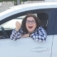 Young Happy Caucasian Woman Showing the Key of New Car - VideoHive Item for Sale