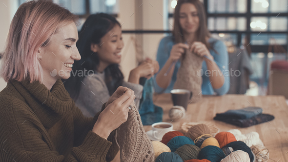 Girls with knitting needles - Stock Photo - Images