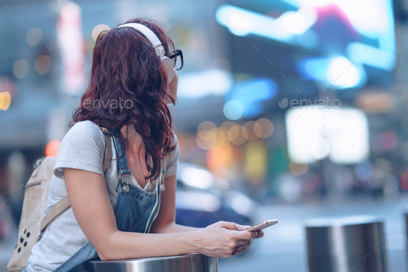 Girl with headphones in New York - Stock Photo - Images