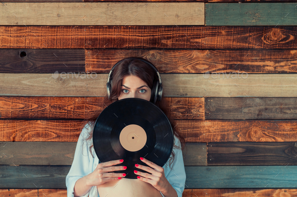 Woman with a phonograph record - Stock Photo - Images