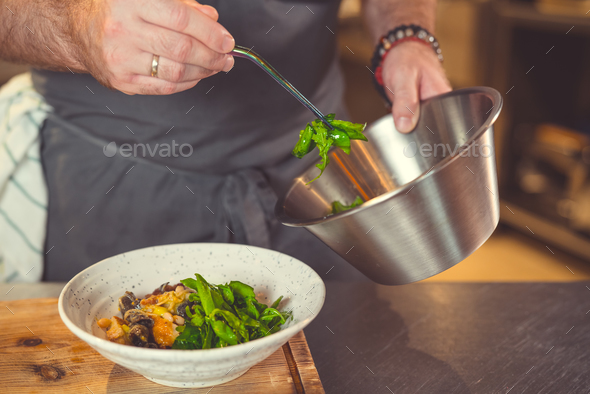 Chef cooking dish - Stock Photo - Images