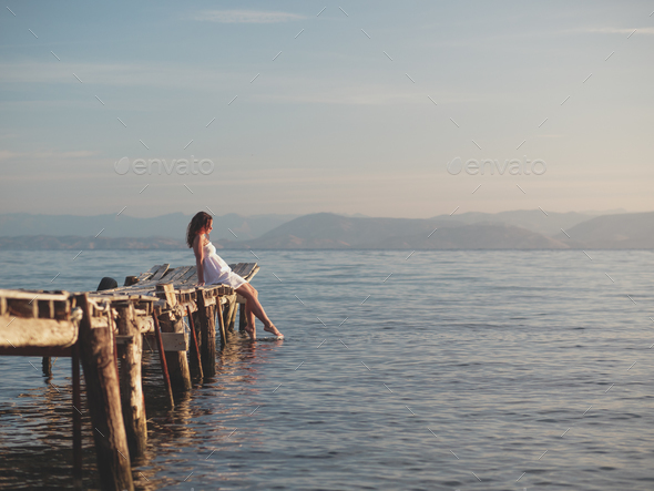 Woman on a pier - Stock Photo - Images