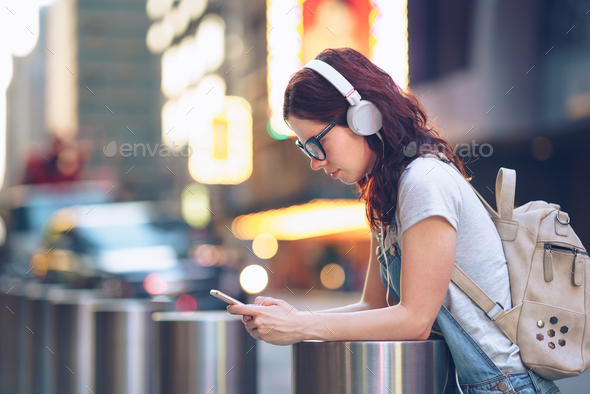 Messaging girl outdoors - Stock Photo - Images