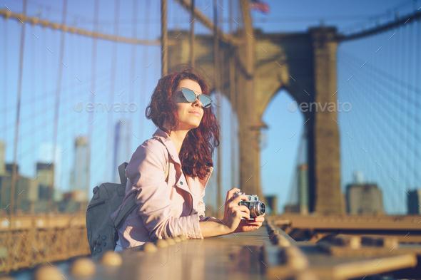Woman on a bridge - Stock Photo - Images
