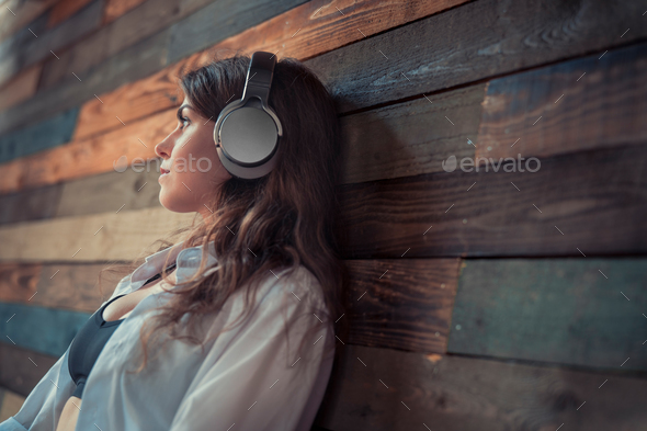 Attractive girl with headphones - Stock Photo - Images