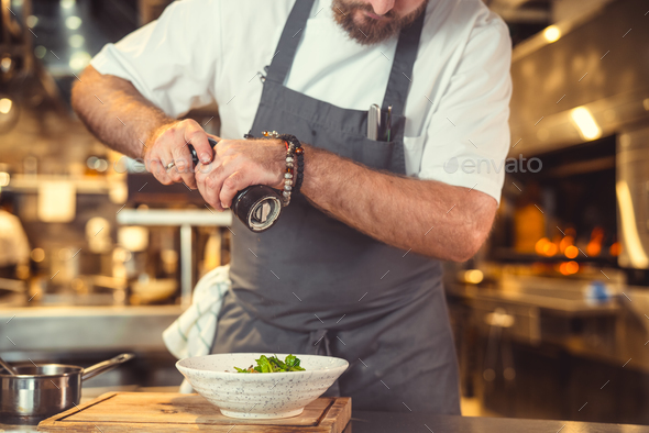 Young cook at work - Stock Photo - Images