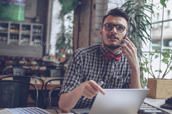 Young designer in cafe - Stock Photo - Images
