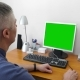 Doctor Sits at the Computer with a Green Screen - VideoHive Item for Sale