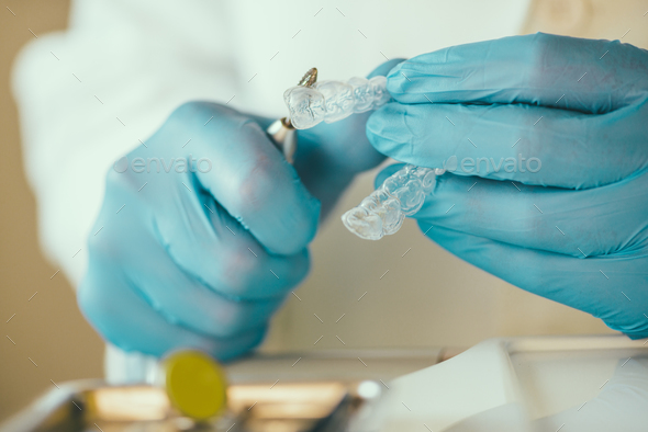 Dentist preparing Invisalign for whitening teeth - Stock Photo - Images