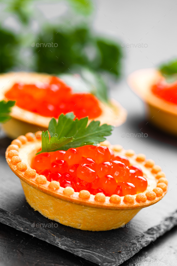 Tartalets with red salmon fish caviar, salmon caviar. Caviar. Selective focus - Stock Photo - Images
